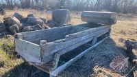 Wooden feed trough and a furnace oil tank