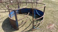Skirted round bale feeder rough condition
