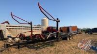 FarmKing 2450 dbl arm rd bale picker