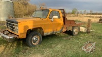 1989 Chevrolet 3500 4x4 s/a reg truck w/8ft flat deck, V8 gas, 3spd with low trans, custom front bumper with winch, 338,929showing, VIN#1GBHV34K6KF301667, Owner: D L Wilson, Seller: Fraser Auction____________