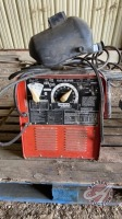 Lincoln 225/125 AC/DC arc welder w/cables and helmet