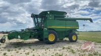 JD 9760 STS combine w/JD 914P header, 2394 threshing & 3335 engine hours showing, s/nS706478
