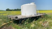 1250-gal poly tank on 4-wheel farm rack
