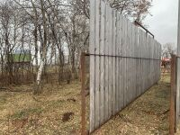 """*30'6"""" free-standing windbreak panels made with 2.5"""" pipe and 8 ft boards"""